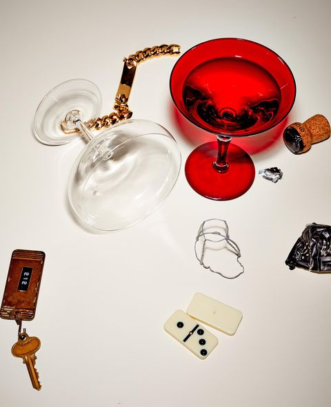 a cocktail glass and various other small objects