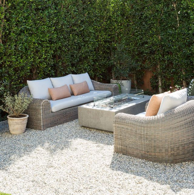 backyard with gravel and firepit
