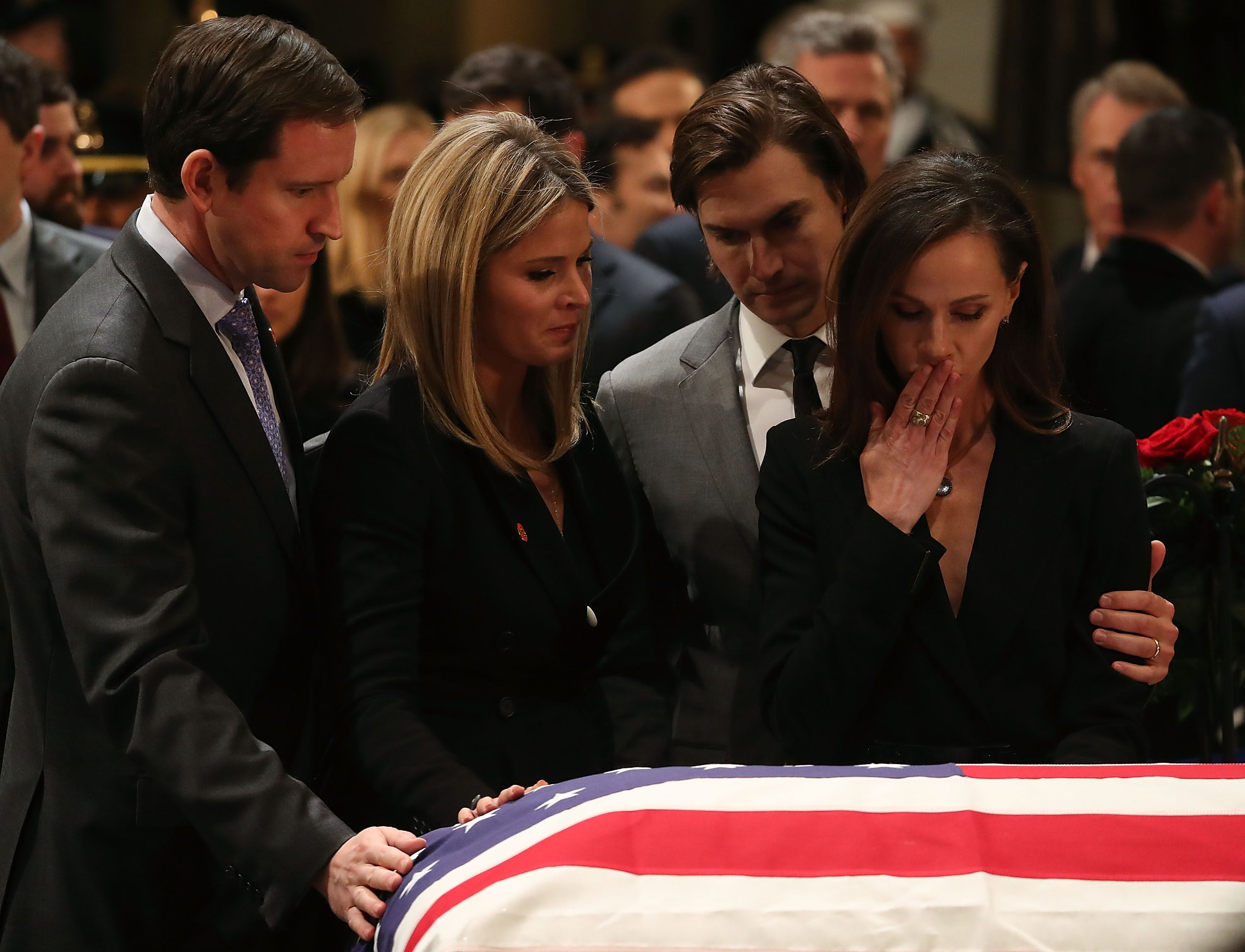 Jenna Bush Hager, her sister Barbara Pierce Bush, and their husbands pay their respects as George H.W. Bush's remains lie in state at the U.S. Capitol.