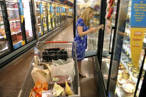 Jennie Sanford used a coupon to get a free carton of ice cream at King Soopers Thursday night, June 23, 2011. Karl Gehring/ The Denver Post