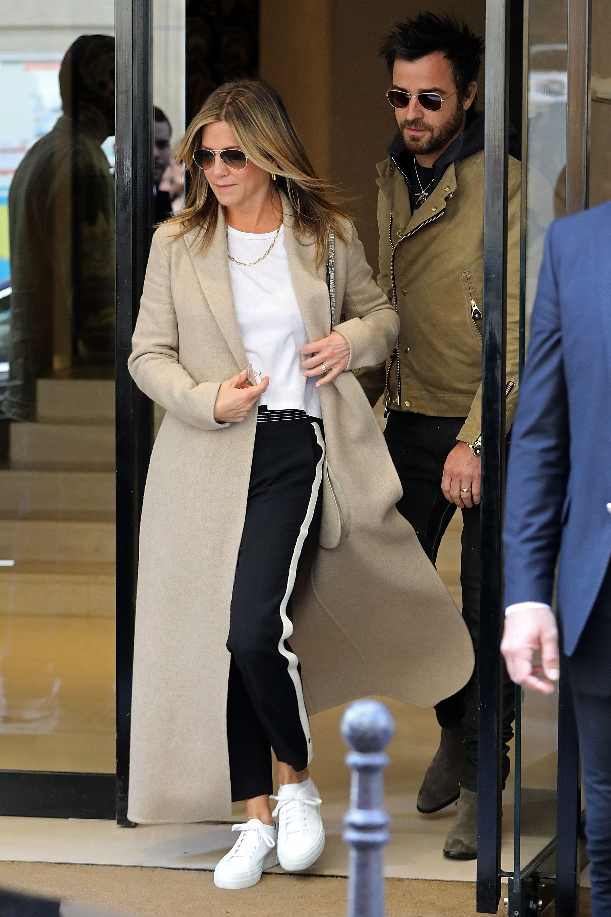 Jennifer Aniston Memorial Day Weekend is all about comfort, so if you plan to live in sweats or track pants all weekend, we completely understand. For cases when you do leave your apartment (to get coffee), cover up with a long beige coat.