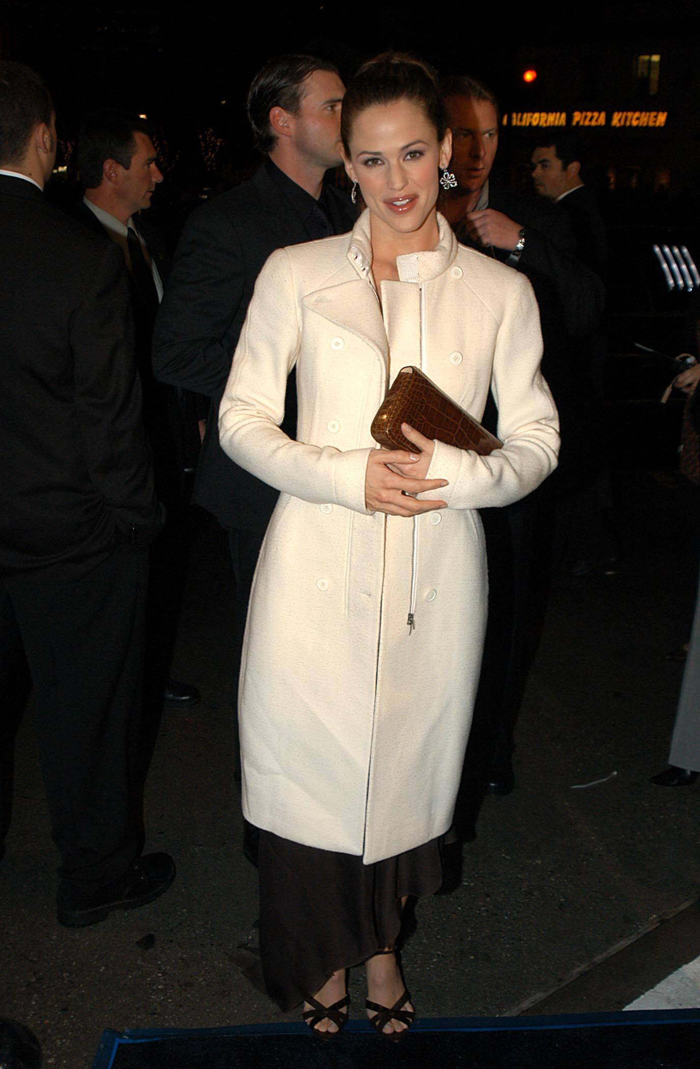 December 16, 2002 In a cream tea-length coat at the premiere of Catch Me If You Can in Westwood, California.