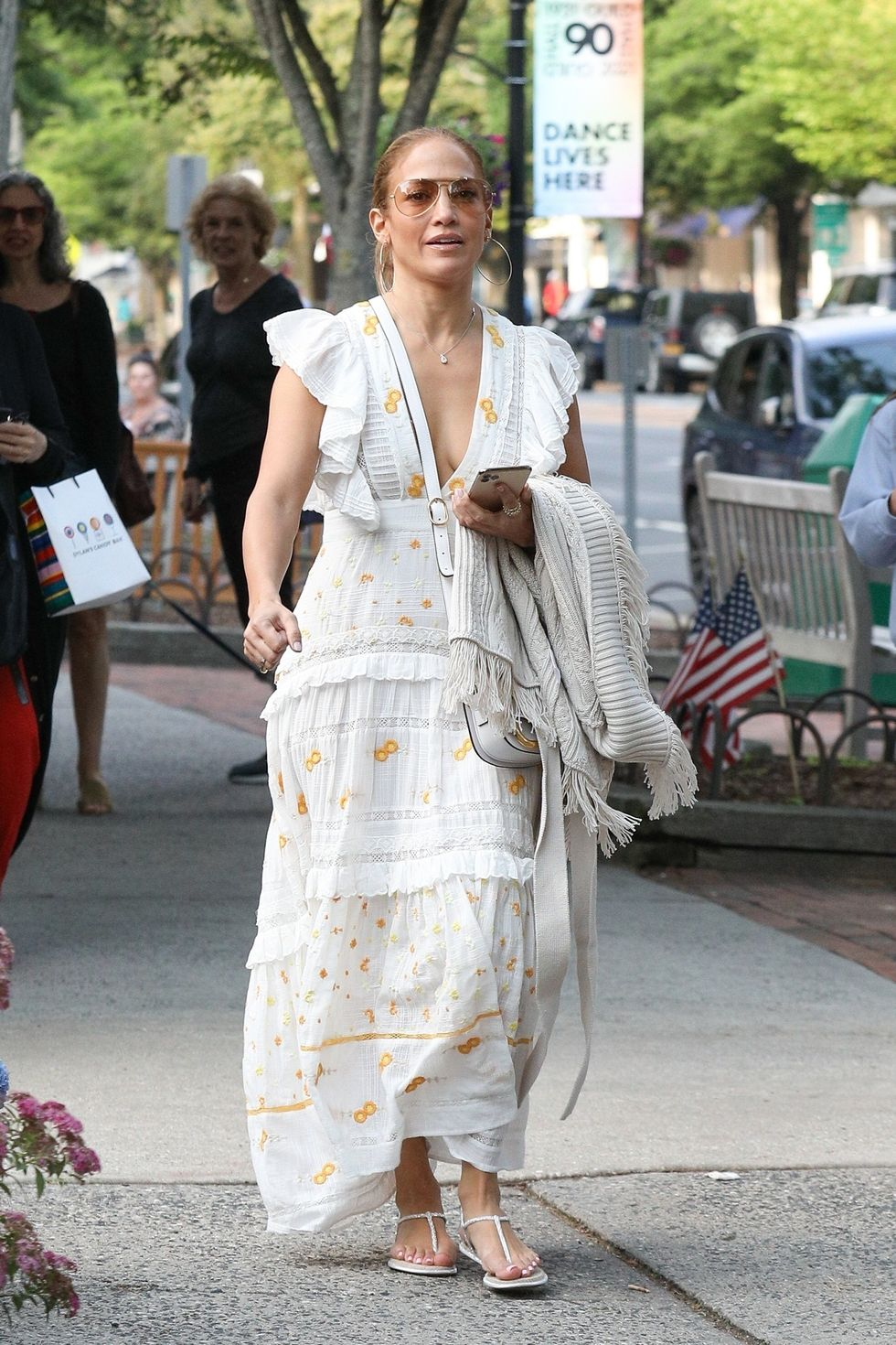 Jennifer Lopez Wore a Chic White Plunge Dress To Go Shopping in the Hamptons