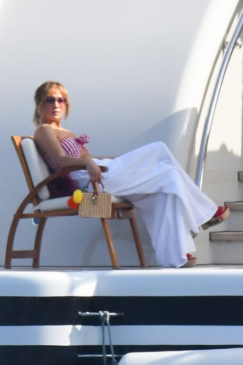 jennifer lopez with top bandeau of white and red navy stripes on her vacation with ben affleck