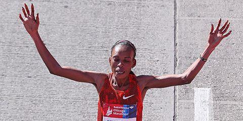 Rita Jeptoo celebrates her victory at the 2014 Chicago Marathon