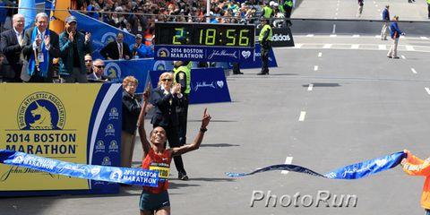 Rita Jeptoo breaks the tape at 2014 Boston Marathon