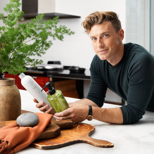 jeremiah brent poses with products from his home essentials line with grove co