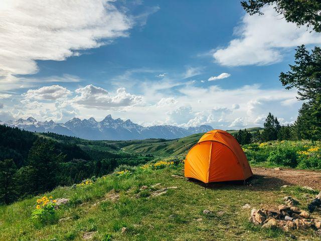 Tent, Natural landscape, Mountainous landforms, Camping, Plant community, Landscape, Leaf, Grassland, Ecoregion, Slope,