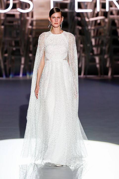 Fashion model, Clothing, Dress, Gown, Wedding dress, Fashion, Shoulder, Haute couture, Bridal clothing, Fashion show,