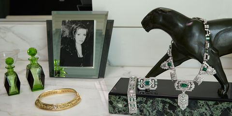 Green, Fashion accessory, Figurine, Jewellery, Bookend, Sculpture, Art,