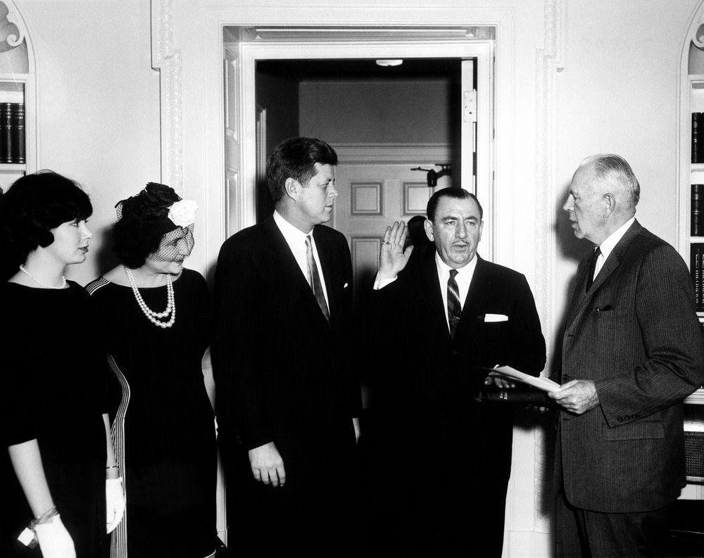 Alongside JFK, Nancy D'Alesandro (later Pelosi) attends Thomas D'Alesandro, Jr.'s swearing in as a member of the Renegotiation Board.