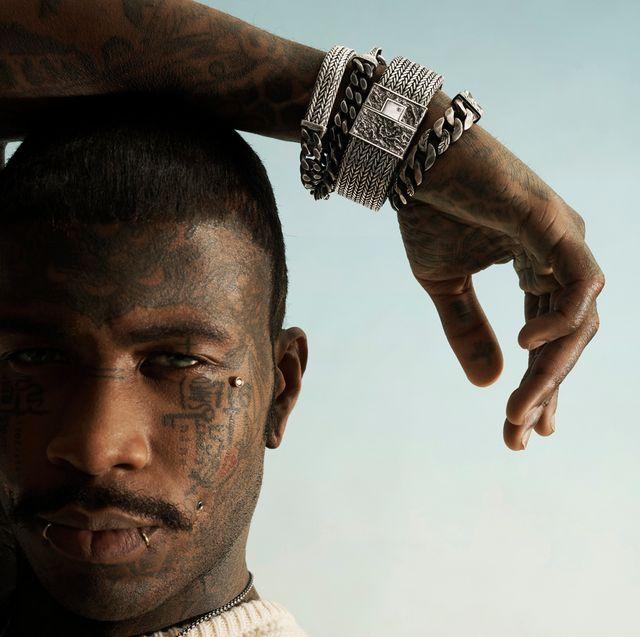 man wearing john hardy bracelets