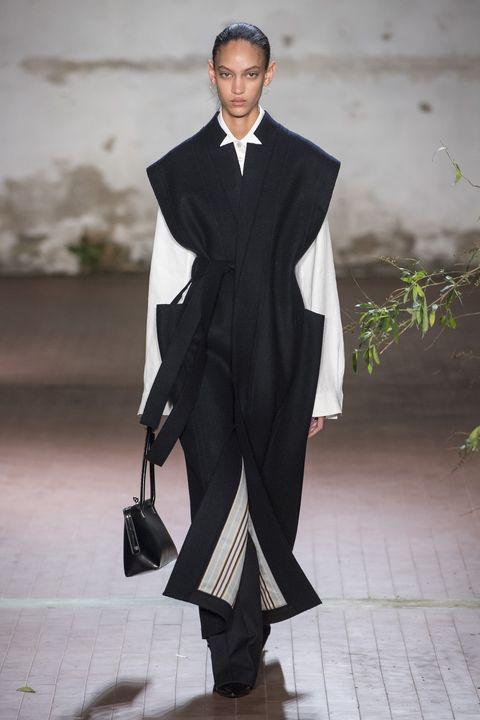 Clothing, Fashion, Formal wear, Outerwear, Suit, Coat, Fashion design, Tuxedo, Haute couture, Mantle,