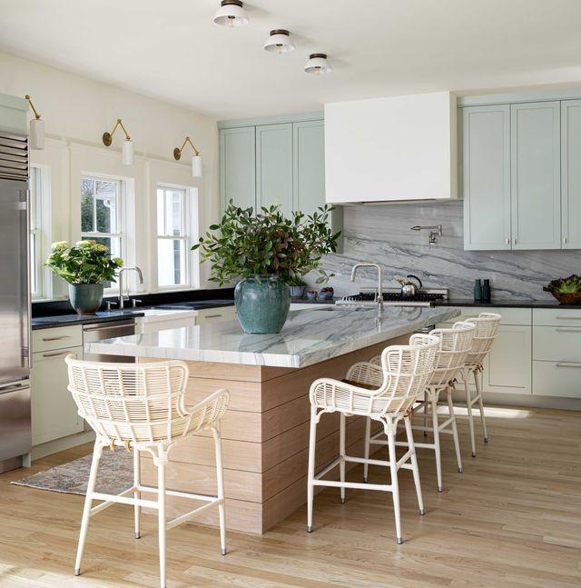 kitchen, green cabinets, black countertops, marble kitchen island, white kitchen bar stools