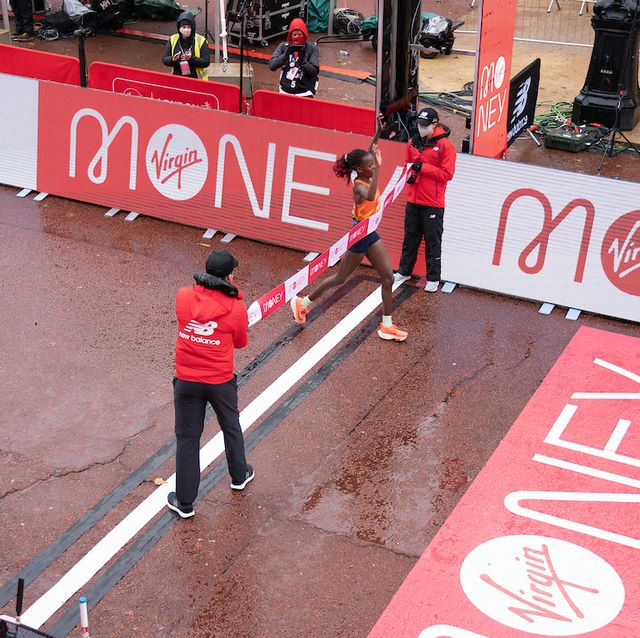 brigid kosgei ken crossing the finish line to win the elite womens race at the historic elite only virgin money london marathon taking place on a closed loop circuit around st jamess park in central london on sunday 4 october 2020  photo jed leicester for virgin money london marathon  for further information medialondonmarathoneventscouk