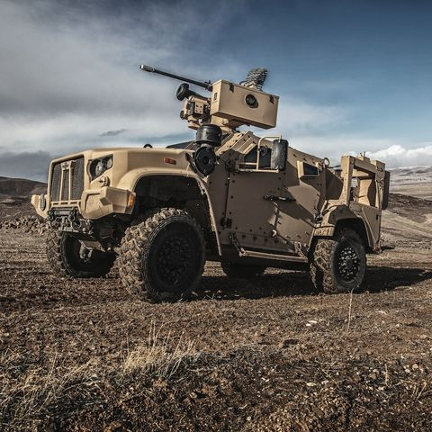 Vehicle, Military vehicle, Armored car, Automotive tire, Tire, Mode of transport, Wheel, Military, Armored car, Off-road vehicle,
