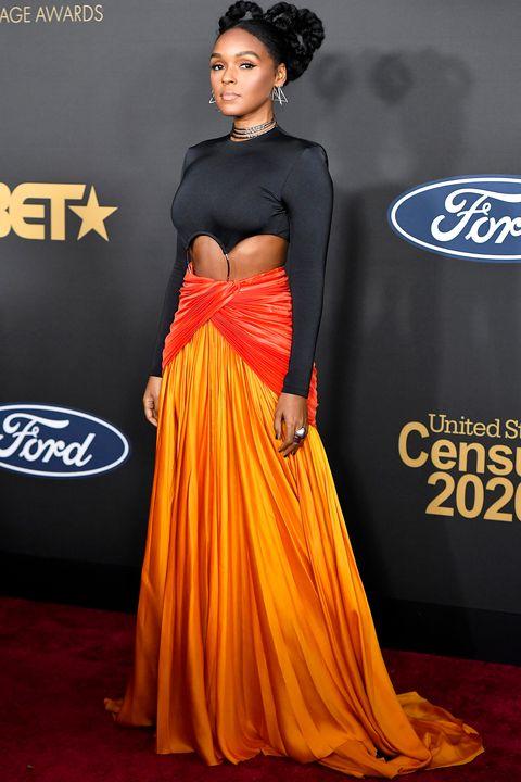 Clothing, Red carpet, Dress, Carpet, Shoulder, Gown, Fashion model, Yellow, Premiere, Fashion,