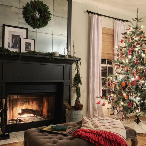 Living room, Hearth, Fireplace, Room, Interior design, Christmas decoration, Home, Christmas tree, Property, Furniture,