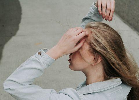 Hair, Hairstyle, Blond, Long hair, Ear, Hair coloring, Neck, Hand, Temple, Gesture,