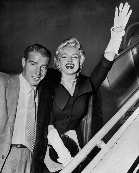 joe dimaggio and marilyn monroe as they board plane at inter