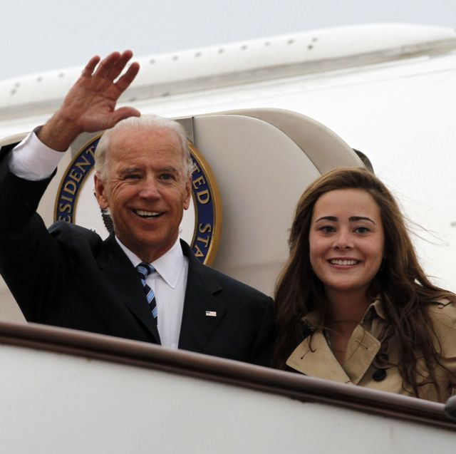 beijing, china   august 17 us vice president joe biden l waves with his granddaughter naomi biden as they walk out from air force two upon arrival at the beijing capital international airport on august 17, 2011 in beijing, china  vice president joe biden, a veteran foreign policy hand during his 36 year senate career, arrived for a five day visit in china under a cloud of criticism over the us debt, as he seeks to build a rapport with xi jinping, the man expected to be the rising asian powers next leader he will later visit emerging us partner mongolia and longstanding ally japan  photo by ng han guan poolgetty images