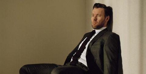 Sitting, Suit, Fashion, Formal wear, White-collar worker, Furniture, Tie, Leg, Photography, Businessperson,