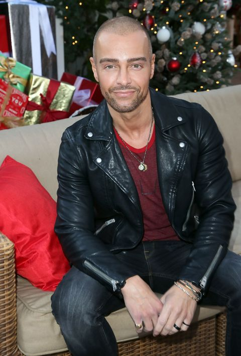 Leather, Jacket, Leather jacket, Facial hair, Textile, Muscle, Outerwear, Beard, Sitting, Christmas,