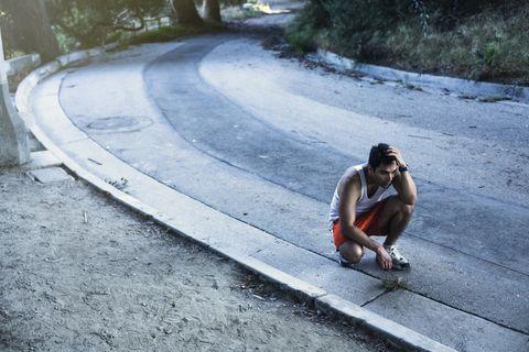 Jogger exhausted, taking break, Arroyo Seco Park, Pasadena, California, USA
