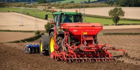 John Deere tractor with front press and rear seed drill planting Oilseed Rape