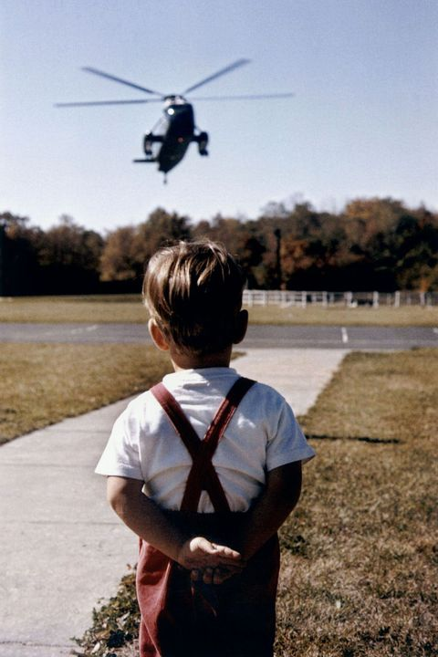 Young John Jr. patiently waiting the helicopter landing and arrival of his father, American President John F. Kennedy.