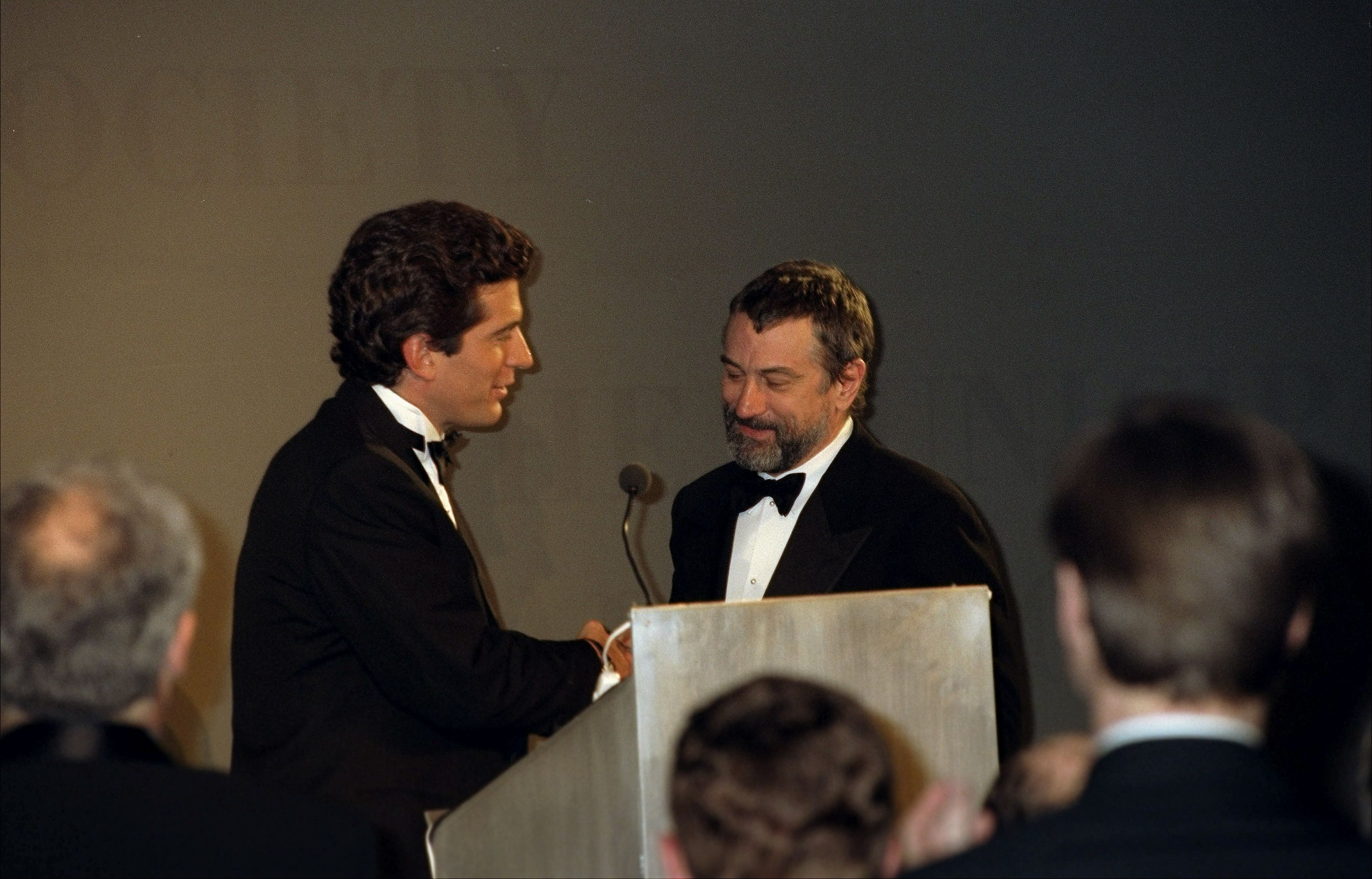 John F. Kennedy Jr. presents Robert De Niro with the Jacqueline Kennedy Onassis Medal during the Municipal Art Society Gala in 1997.