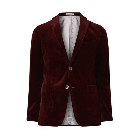 Shop in de stijl van John Legend. Het rode fluwelen pak.