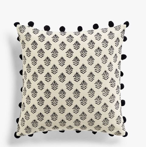 John Lewis & Partners, £20, cushion with pom-poms