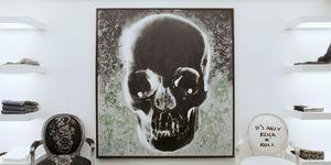 John Richmond, Conduit Street, London, W1, United Kingdom Architect:  Francesco Rota John Richmond, Showroom, Francesco Rota, London, View Of Shelving Unit And Skull Painting On Wall