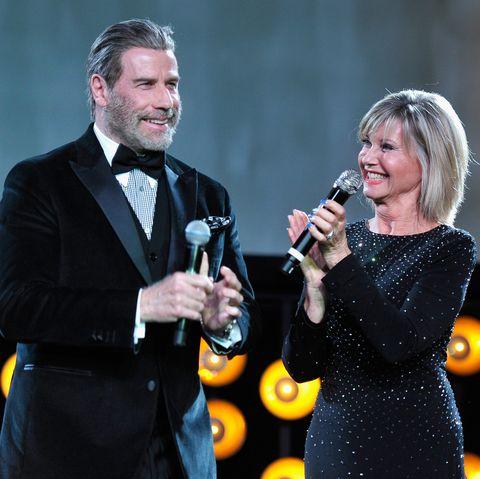 john travolta and olivia newton-john at g'day usa gala 2018