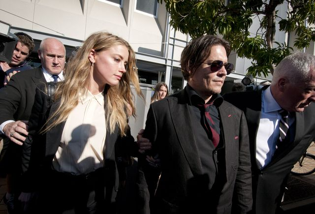 model, amber heard, and her husband, johnny depp, leave southport magistrates court, queensland, april 18, 2016 heard received a fine for bringing pet dogs, pistol and boo, illegally into australia in 2015 photo by robert shakespearefairfax media via getty images via getty images