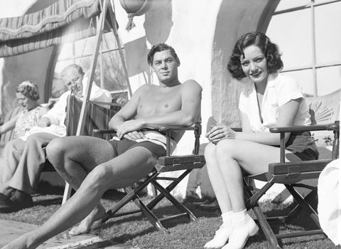 weismuller and lupe velez seated at hote