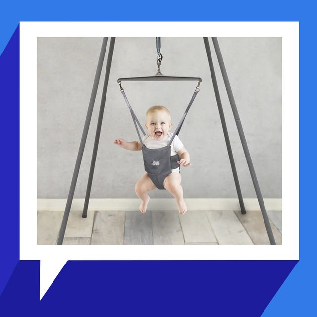 baby in jolly jumper with stand
