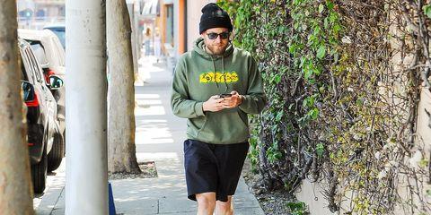 Green, Clothing, Street fashion, Outerwear, Headgear, Jacket, Cap, Tree, Photography, T-shirt,