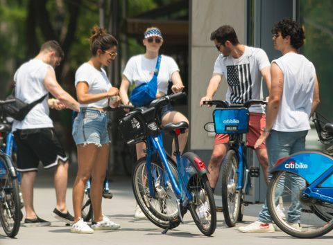 Priyanka Chopra, Nick Jonas, Joe Jonas, and Sophie Turner bike riding in New York City.