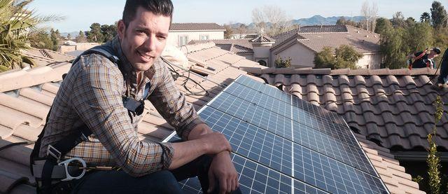 jonathan scott on roof with solar panels