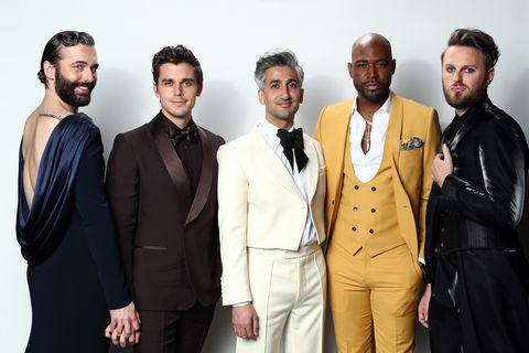 tan france center with the queer eye cast