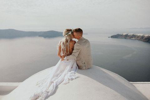 Photograph, Wedding dress, Bride, Bridal clothing, Honeymoon, Gown, Romance, Bridal accessory, Dress, Wedding,