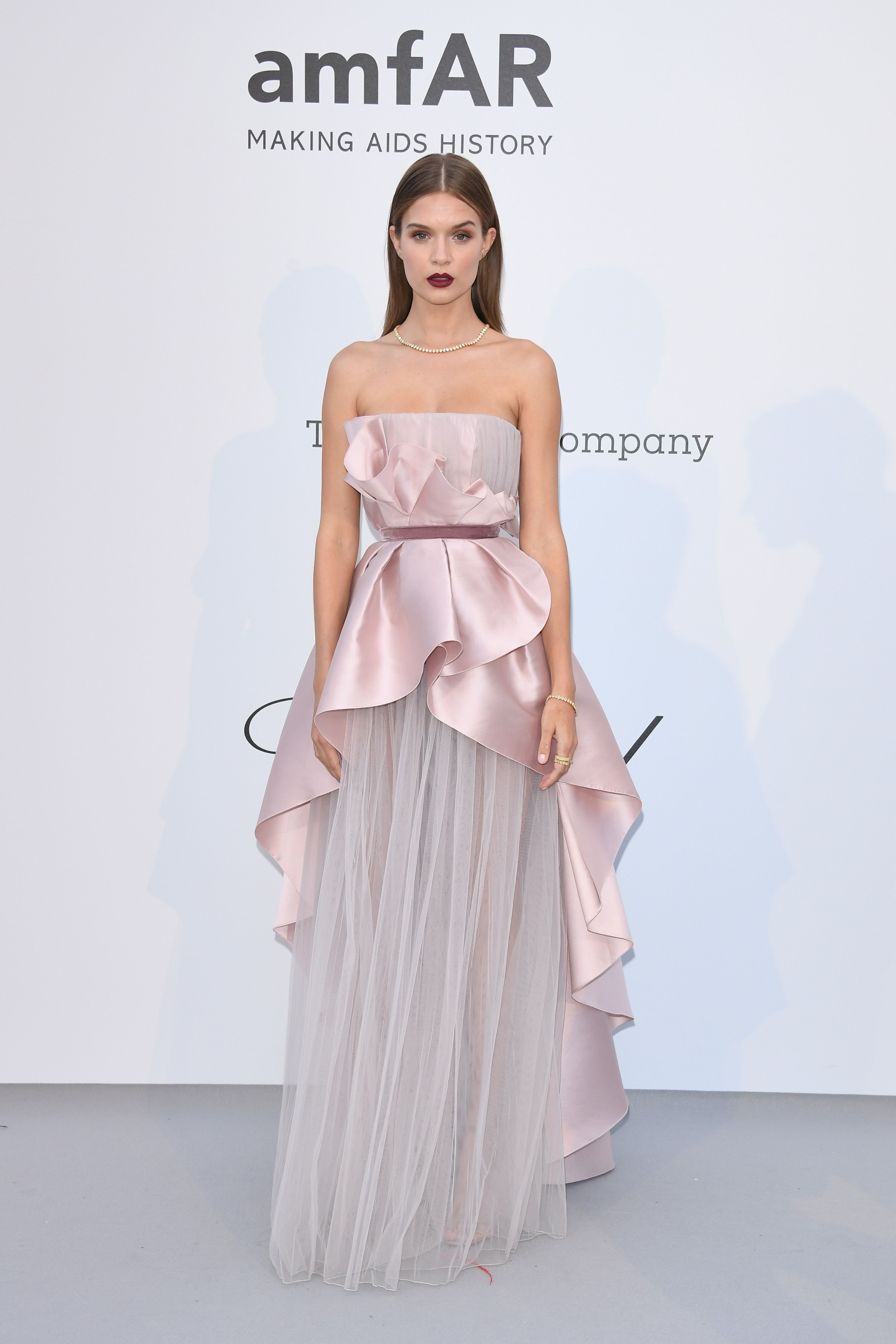 Josephine Skriver In a pale pink strapless gown.