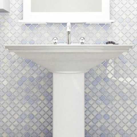 porcelain mosaic wall tile in purple and white behind sink