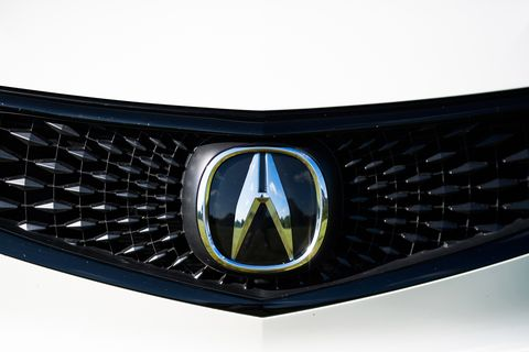Grille, Vehicle, Automotive lighting, Car, Emblem, Headlamp, Bumper, Automotive exterior, Hood, Automotive fog light,