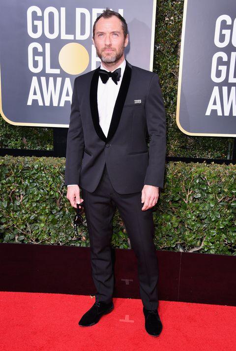 Suit, Formal wear, Red carpet, Tuxedo, Carpet, Clothing, Premiere, Outerwear, Blazer, Tie,