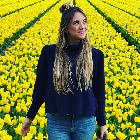 People in nature, Yellow, Flower, Plant, Spring, Rapeseed, Mustard plant, Smile, Outerwear, Flowering plant,