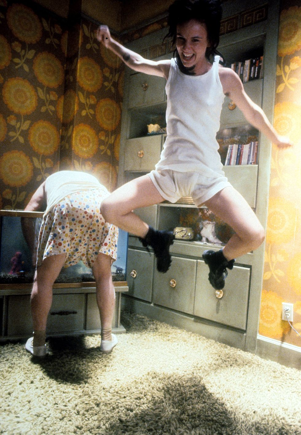 Natural Born Killers (1994) Juliette Lewis jumps in a scene during Natural Born Killers. The movie was a huge hit, grossing over $50 million in theaters.