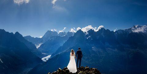 Sky, Dress, Mountainous landforms, Bridal clothing, Bride, Gown, Mountain, Wedding dress, Marriage, Mountain range,